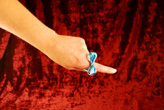 Reminder. Tie a ribbon around your finger as a reminder Royalty Free Stock Photography