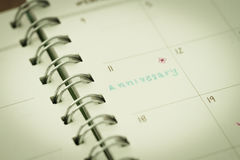 Reminder for anniversary in planner Stock Image
