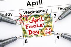 Reminder April fools day in calendar with four pens. Close-up Stock Photos