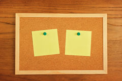 Reminder blank notes paper on cork board Stock Image