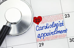Reminder Cardiologist Appointment in calendar and stethoscope Stock Photos
