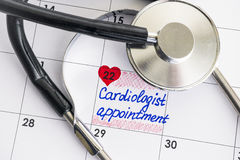 Reminder Cardiologist Appointment in calendar with stethoscope Stock Photography