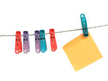 Reminder with clothes peg. Over white Stock Photos