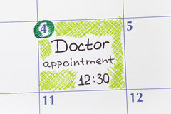 Reminder Doctor appointment in calendar. Reminder Doctor appointment 12-30 in calendar royalty free stock photos