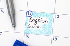 Reminder English lesson in calendar with pen Royalty Free Stock Images