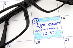 Reminder Eye exam appointment in calendar with glasses Royalty Free Stock Photo
