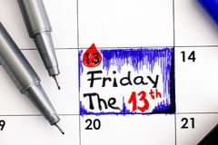 Reminder Friday The 13th in calendar with pens. Stock Photography