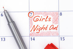 Reminder Girls Night Out in calendar with pen. Reminder Girls Night Out in calendar with red pen Royalty Free Stock Image