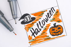 Reminder Halloween in calendar with pens Stock Images