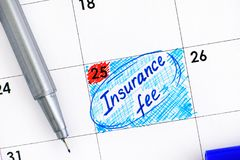 Reminder Insurance Fee in calendar with blue pen. Royalty Free Stock Photos