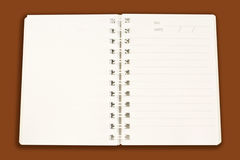 reminder lined ring binder notebook. On brown background Stock Images