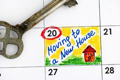 Reminder Moving to a New House in calendar with key. Royalty Free Stock Image