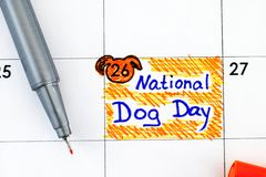 Reminder National Dog Day in calendar with pen
