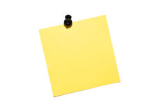 Reminder note. Yellow reminder note with black pin isolated on white background stock photo