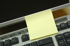Reminder note. Empty Postit note attached to a modern computer LCD screen Stock Image