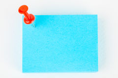 Reminder note. Blue reminder note with red pin on white paper background royalty free stock image