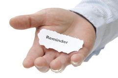 Reminder - Note Series. Businessman holding Reminder note with white copy space stock images