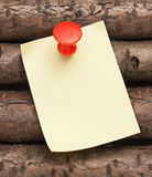 Reminder notes. On a background of the old wooden logs Royalty Free Stock Image