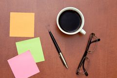 Reminder notes, pen and glasses with cup of coffee Royalty Free Stock Images