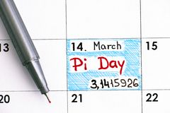Reminder Pi Day in calendar with red pen. Pi Day is celebrated on March 14th 3/14 around the world royalty free stock images