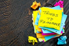 Things to remember sticky notes trash. Reminder postit sticky notes pile stack things to remember to do list home love trash Royalty Free Stock Photos