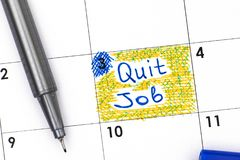 Reminder Quit Job in calendar with pen. Reminder Quit Job in calendar with blue pen. Close-up royalty free stock photography