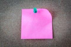 Reminder sticky note on cork board, empty space for text. Reminder sticky note on a cork board, empty space for text Royalty Free Stock Photos