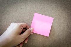 Reminder sticky note on cork board, empty space for text. Reminder sticky note on a cork board, empty space for text Stock Photo