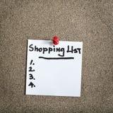Reminder sticky note on cork board Royalty Free Stock Photo