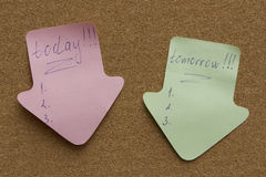 Reminder sticky note on cork board Stock Image