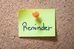 Reminder sticky notes pinned on the cork or bulletin board stock photography