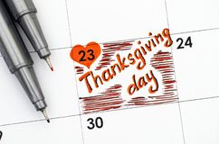 Reminder Thanksgiving day in calendar with two pens. Stock Photography