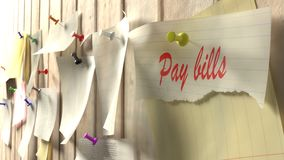 Reminder to pay the bills pinned to kitchen wall Stock Image