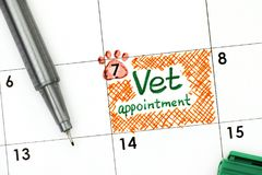 Reminder Vet Appointment in calendar with green pen. Close-up Stock Photography