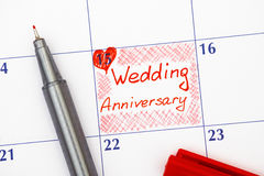 Reminder Wedding Anniversary in calendar with pen. Reminder Wedding Anniversary in calendar with red pen Royalty Free Stock Photos