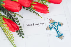 Reminder Wedding day on calendar with cross Stock Images