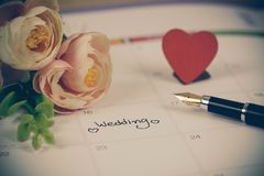 Reminder Wedding day in calendar planning. And fountain pen with color tone royalty free stock images