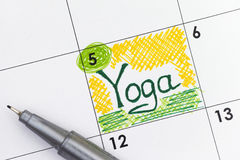 Reminder Yoga in calendar with pen Royalty Free Stock Photography
