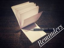 Reminders. Notepad with a pen on table to write the reminders for day week year Royalty Free Stock Image