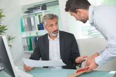 Reminding boss about meeting. Reminding the boss about a meeting Stock Photography