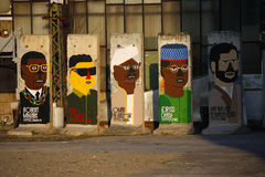 Remnant of Berlin Wall. JANUARY 2012 - BERLIN: Robert Mugabe (Zimbabwe), Kim Jong-il (North Korea), Umar al-Baschir (Sudan), Idriss Deby (Chad), Mahmud Royalty Free Stock Images