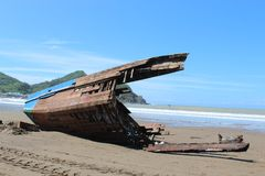 Remnant of a fishing Boat after Hurricane Nate. The remnants of a fishing boat on the beach after Hurricane Nate in San Juan Del Sur, Nicaragua Royalty Free Stock Image