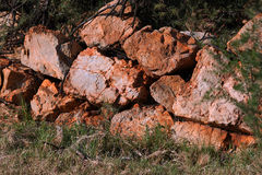 REMNANT OF OLD ROCK WALL. Rocks formerly part of a farm wall Stock Images