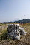Remnants of ancient Greece. A view of pieces of carvings and remnants of ancient Greece in an open field near Amphipolis, Greece Stock Image