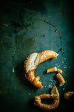 Remnants of a broken pretzel Stock Photos