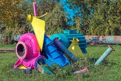 Remnants of industrial equipment painted in bright colors Stock Images