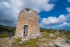 Remnants of an old windmill in Askos royalty free stock photography