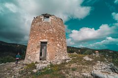 Remnants of an old windmill in Askos royalty free stock image