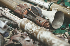 Remnants of shells anti-tank rocket propelled grenade launcher and High Mobility Artillery Rocket System Royalty Free Stock Image