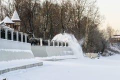 Remoção de neve do local Fotos de Stock Royalty Free